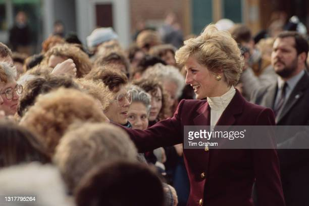 British Royal Diana, Princess of Wales , wearing a burgundy outfit with an ivory polo neck top, greets well-wishers during a visit to Oxford,...