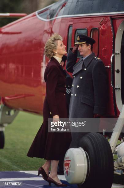 British Royal Diana, Princess of Wales , wearing a burgundy outfit with an ivory polo neck top, leaves in a Westland Wessex helicopter after a visit...