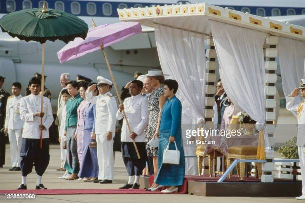 British Royal Diana, Princess of Wales , wearing a dress by Alistair Blair and a Philip Somerville hat, standing with unspecified Thai dignitaries on...