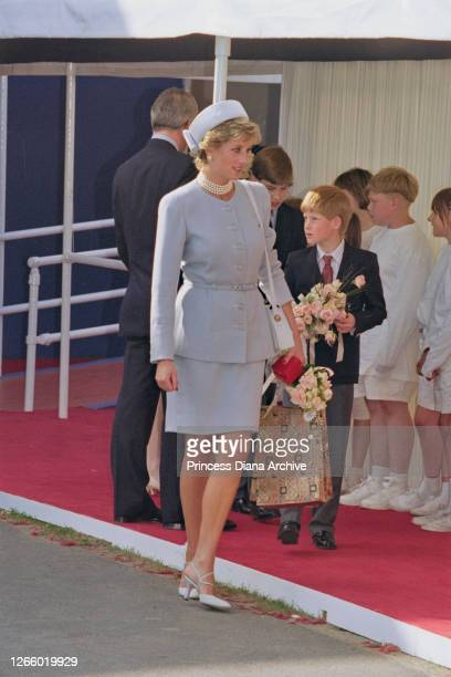 British Royal Diana, Princess of Wales , wearing a light blue suit and matching pillbox hat, with a multi-strand pearl necklace, and her son Prince...