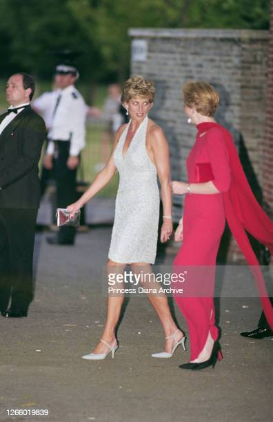 British Royal Diana, Princess of Wales , wearing a pale blue halter-neck dress by fashion designer Catherine Walker, with co-director of the...