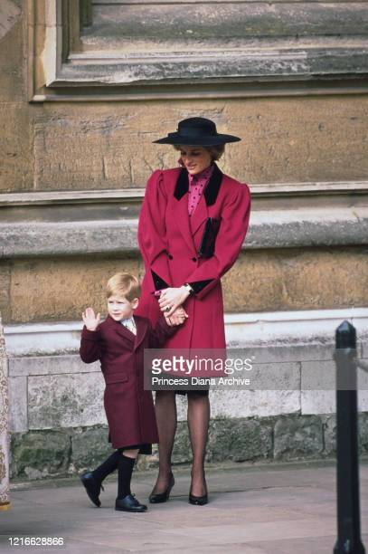 British royal Diana Princess of Wales wearing a red coat with black lapels and a black hat and Prince Harry attend the Easter service at St George's...