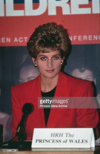 British royal Diana, Princess of Wales , wearing a red jacket over a black top, addresses the 'Housing our Children' conference, held at the Queen...