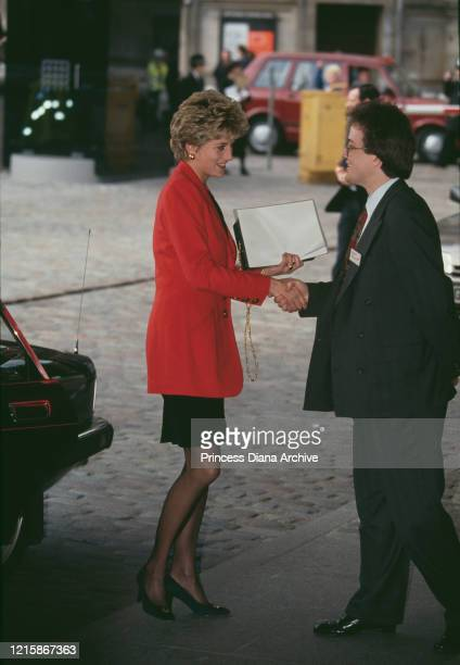 British royal Diana, Princess of Wales , wearing a red jacket with a black skirt, as she arrives at the 'Housing our Children' conference, held at...