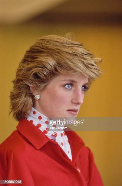 British Royal Diana, Princess Of Wales wearing a red suit, with a red polka dot blouse beneath a peplum jacket, attends the Suffolk Show, an annual...