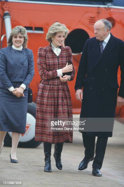 British royal Diana Princess of Wales wearing a red tartan suit by Caroline Charles after her arrival by royal helicopter for a visit to Swindon...