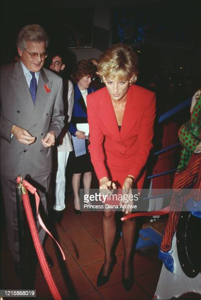 British royal Diana Princess of Wales wearing a red twopiece suit by Catherine Walker during a visit to London Lighthouse a centre for people...