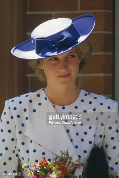 British royal Diana, Princess of Wales , wearing a white outfit with blue polka dots by Jan Van Velden, and a blue hat, during a visit to Canberra,...