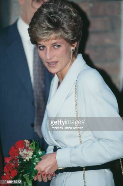 British royal Diana Princess Of Wales wearing a white suit with a broad black belt during a visit to the Mortimer Market Centre a sexual health...