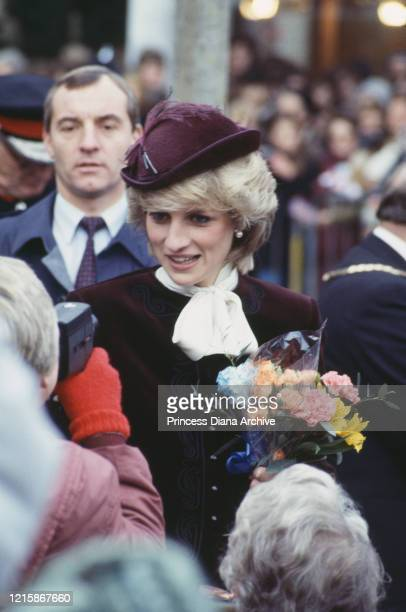 British royal Diana, Princess of Wales , wearing a wine-coloured velvet suit by Jaeger with a hat by John Boyd, during a visit to St Austell in...
