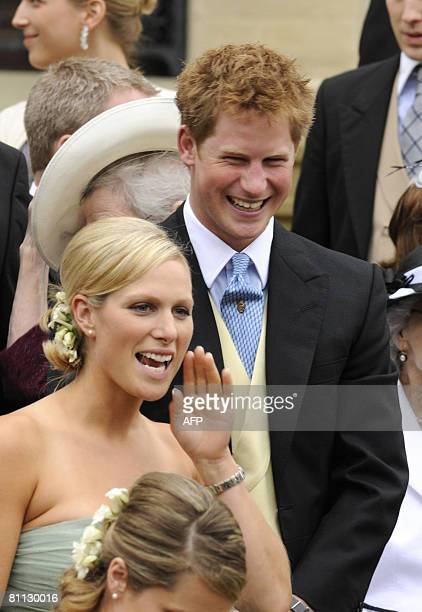 British royal family member Zara Phillips calls out beside Prince Harry during the wedding of her brother Peter Phillips 30 to Autumn Kelly 31 at St...