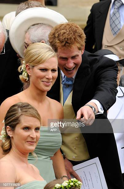 British royal family member Zara Phillips talks to Prince Harry during the wedding of her brother Peter Phillips 30 to Autumn Kelly 31 at St George's...