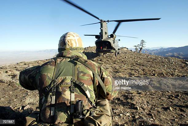 British Royal Marine Commando watches as a chinook helicopter takes off after a resupply mission during Operation Ptarmigan April 17 2002 in Eastern...