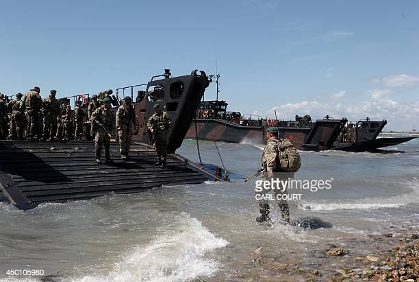British Royal Marine Commandos demonstrate a beach landing a beach landing demonstration during DDay commemorations in Portsmouth in southern England...