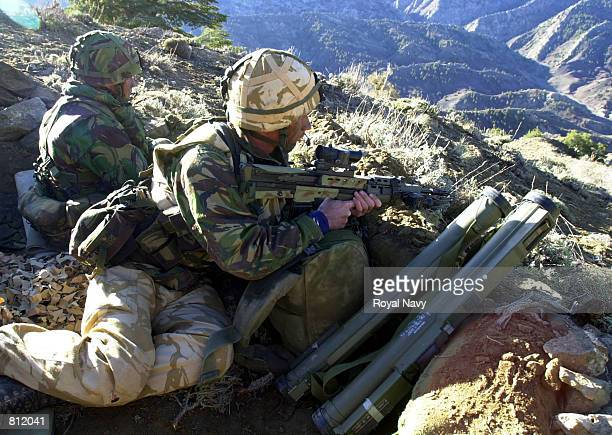 British Royal Marine Commandos from 45 Commando RM man an Observation Post in the mountains of Afghanistan during Operations against the Taliban and...