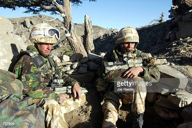 British Royal Marine Commandos sit in their fighting position during Operation Ptarmigan April 17 2002 in Eastern Afghanistans Ginger Valley About...