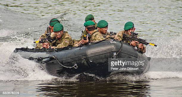 British Royal Marine Commandos the put on a display of military culture on the River Trent in Nottinghamshire on the National Armed Forces Day in 2013