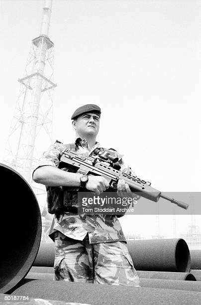 A British Royal Marine guards a petrochemcial plant in the Rumaila oil field southern Iraq during the Americanled invasion of the country March 2003