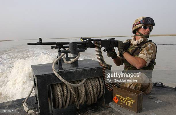 A British Royal Marine of 539 Assault Squadron with a heavy machine gun while on patrol during the first days of the Americanled invasion of Iraq...