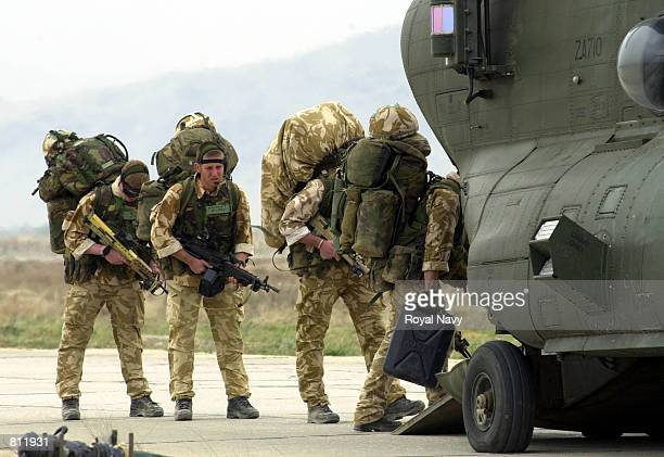 British Royal Marines board a Chinook helicopter April 13 2002 at Bagram air base Afghanistan to be deployed into the mountains of Afghanistan as...