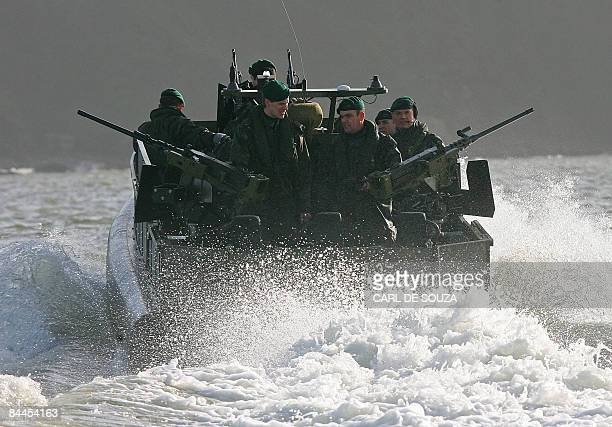 British Royal Marines carry out exercises onboard a new Mid-Console Variant Offshore raiding craft during an open day for the press in Plymouth,...
