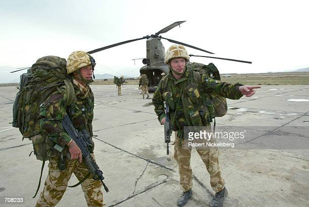 British Royal Marines from the 45 Commando move across the airstrip during an exercise at Bagram Air Base April 14 2002 in Afghanistan