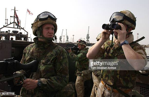 British Royal Marines of 539 Assault Squadron entering the port at Umm Qasar during the first days of the Americanled invasion of Iraq March 2003 The...