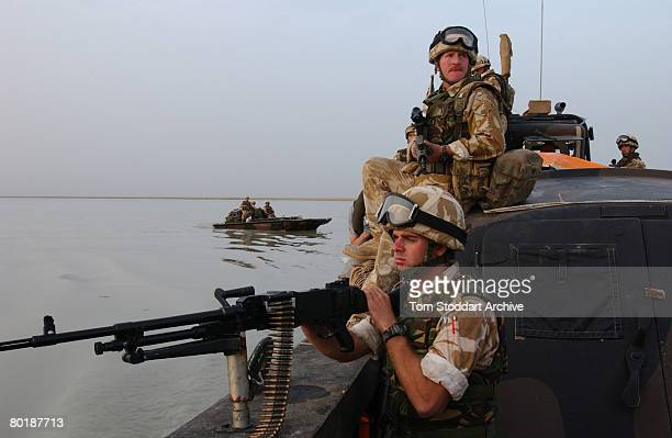 British Royal Marines of 539 Assault Squadron train their weapons on the marshes near Basra in case of ambush, while on patrol during the first days...