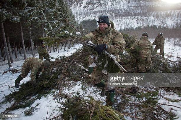 British Royal Marines receive survival training constructing shelters March 4 2013 during three months of training at the Allied Arctic Training...