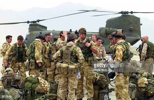 British Royal Marines wait to board a Chinook helicopter April 13 2002 at Bagram air base Afghanistan to be deployed into the mountains of...