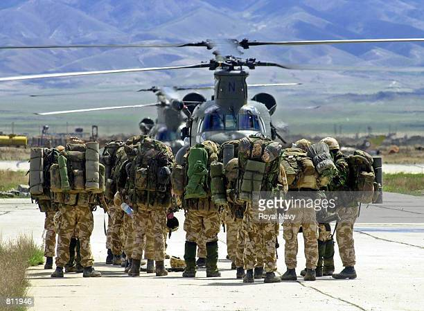 British Royal Marines wait to board a Chinook helicopter April 15, 2002 at Bagram air base, Afghanistan, to be deployed into the mountains of...