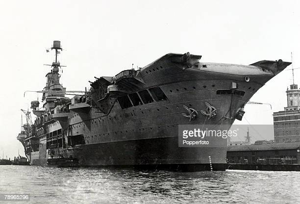 circa 1940 British aircraft carrier HMS Ark Royal of the Royal Navy pictured in Portsmouth Harbour after its refit