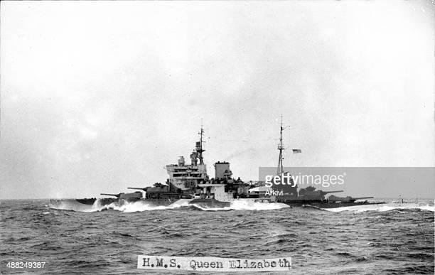 British Royal Navy Battleship HMS Queen Elisabeth, A10944, in dazzle camouflage at sea, ca. 1943.