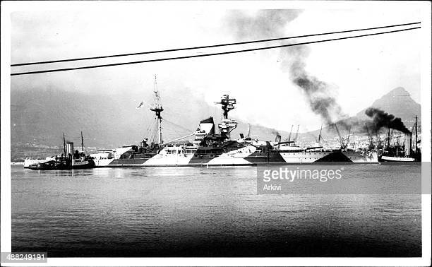 British Royal Navy Battleship HMS Royal Sovereign in dazzle camouflage anchoring in an undisclosed naval port ca 1940