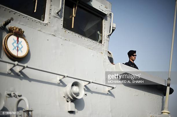 A British Royal Navy sailor aboard a ship takes part in the International Mine Countermeasures Exercise organised by the US Navy at its Naval Support...