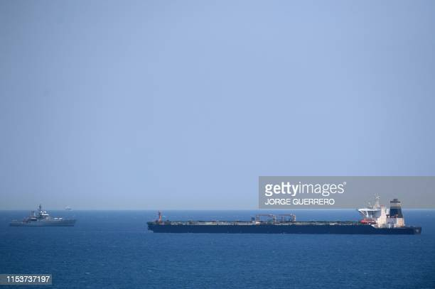 A British Royal Navy ship patrols near supertanker Grace 1 suspected of carrying crude oil to Syria in violation of EU sanctions after it was...
