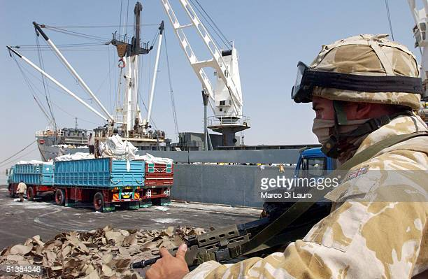 British Royal Navy soldier patrols the commercial harbor October 2 2004 in Umm Qasr Iraq The British Royal Navy has provided training and support to...