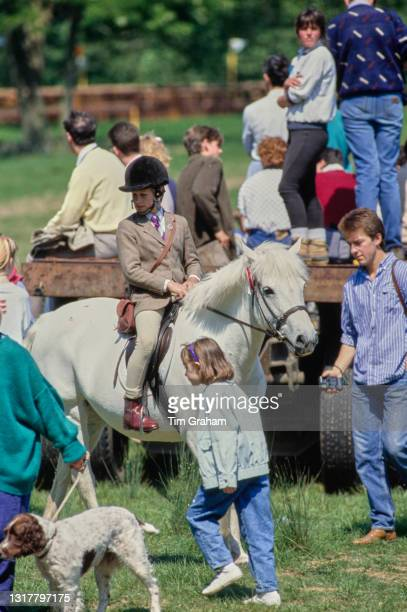 British Royal Peter Phillips, wearing a tweed hacking jacket and beige jodhpurs, on his pony among unspecified spectator attending the Royal Windsor...