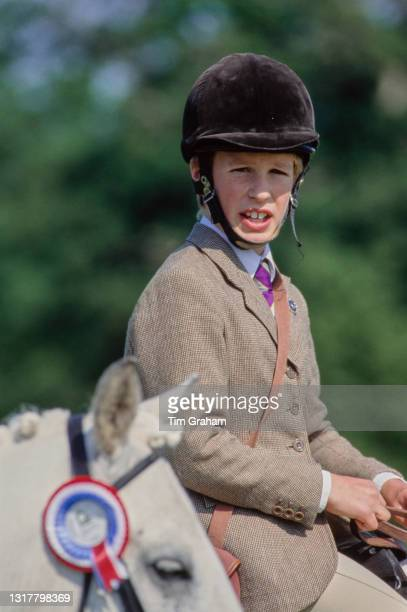 British Royal Peter Phillips, wearing a tweed hacking jacket and beige jodhpurs, on his pony at the Royal Windsor Horse Show, held at Home Park on...