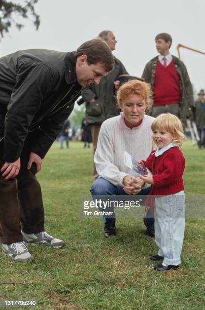British Royal Prince Andrew, Duke of York, with his wife Sarah, Duchess of York, and their daughter, Princess Beatrice attending the Royal Windsor...