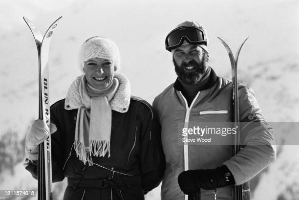 British royal Prince Michael of Kent and his wife Princess Michael of Kent, both smiling as they hold their skis on the slopes, 7th January 1985.