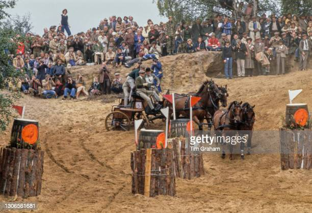 British Royal Prince Philip, Duke of Edinburgh steering his carriage around an obstacle as he competes in the World Carriage Driving Championships at...