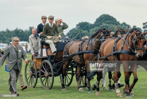 British Royal Prince Philip, Duke of Edinburgh, with Princess Anne sitting behind, as he competes in the World Carriage Driving Championships, at...