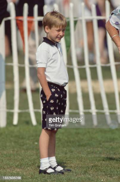 British Royal Prince William stands with his hands in his pockets during the Cartier International Polo Day, held at the Guards Polo Club, Smiths...