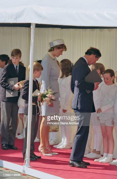 British Royal Prince William, with his brother Prince Harry, mother Diana, Princess of Wales , wearing a light blue suit and matching pillbox hat,...