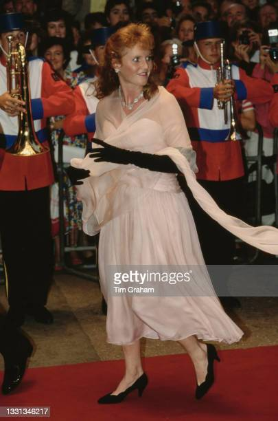British Royal Sarah, Duchess of York, wearing a pale pink evening gown with black evening gloves, attends the premiere of 'The Return of the...