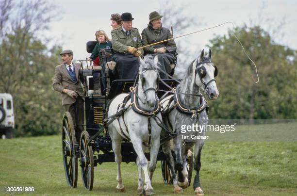 British Royal Zara Phillips, wearing a Windsor Horse Trials sweatshirt, and her nanny, Sarah Minty, riding a carriage at the Royal Windsor Horse...