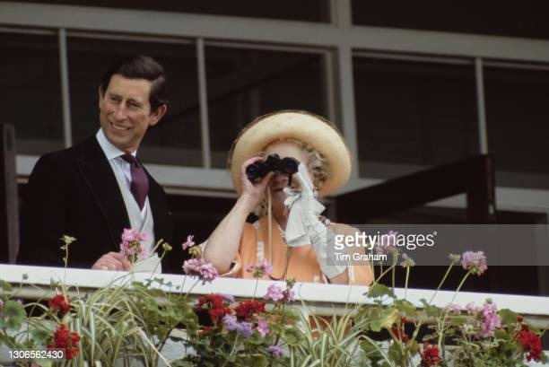 British Royals Charles, Prince of Wales and Queen Elizabeth The Queen Mother watching on Derby Day from the balcony of the Royal Box at Epsom...