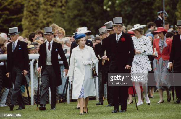British Royals Charles, Prince of Wales, Queen Elizabeth ll, Prince Philip, Duke of Edinburgh and Diana, Princess of Wales , wearing a dress by...