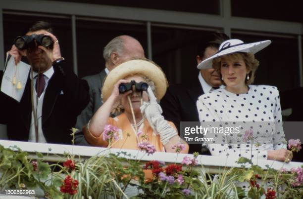 British Royals Charles, Prince of Wales, Queen Elizabeth The Queen Mother , and Diana, Princess of Wales , wearing a dress by Victor Edelstein and...